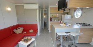 Coin séjour et cuisine location mobil home premium